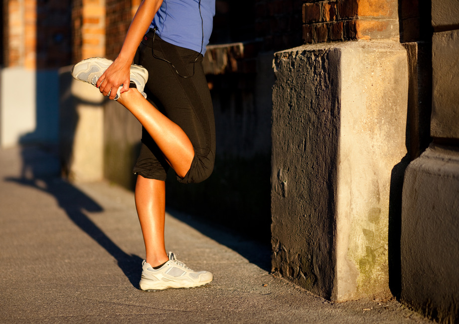 A woman stretching/warming up before jogging.