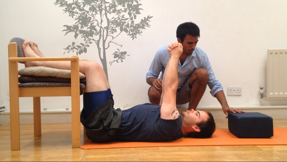 Egoscue Posture Correction exercise done on the floor